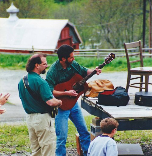 Cliff Davids on guitar (with friend) at the Eliada Founders Day Celebration on April 18, 2000