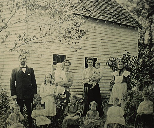 Compton, with the original nine orphans, in front of The Cabin