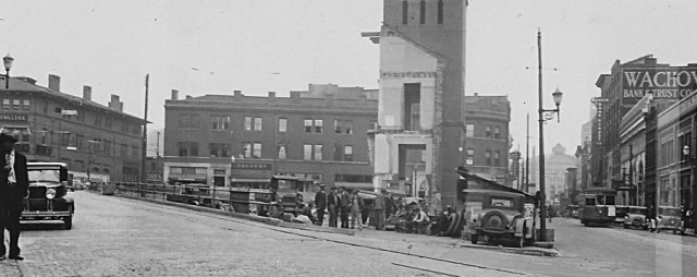 """The last of the old post office, Asheville, N.C. Spring 1932"" The trolley is heading up Patton Avenue towards Vance Monument and City Hall. The College Street curve is on the left."