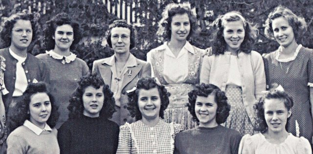 Ruby Cogburn (standing third from right) poses with her Eliada sisters in front of the Main Administration Building.