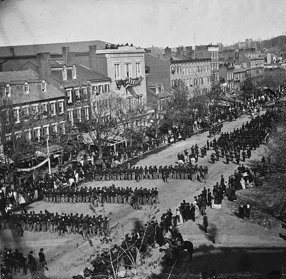 Funeral procession for Abraham Lincoln on April 19, 1865, making its way on Pennsylvania Ave. from the White House to the U.S. Capital. His body was then taken by train to Springfield, Ill. for burial