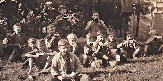Enjoying a watermelon break. Curly is standing center, David Harrison to his left in back.