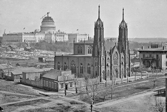 Trinity Church with the U. S. Capital Building Dome under construction during the Civil War.