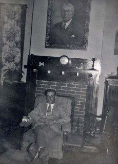 David sitting under Dad's portrait
