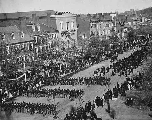 Procession for Abraham Lincoln on Pennsylvania Ave. from the White House to the U.S. Capital on April 19, 1865–his body lay in state there before traveling by train to Springfield, Ill. for burial