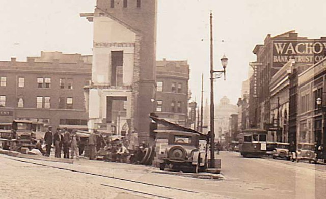 """The last of the old post office, Asheville, N.C. Spring 1932"" The trolley is heading up Patton Avenue towards Vance Monument and City Hall."