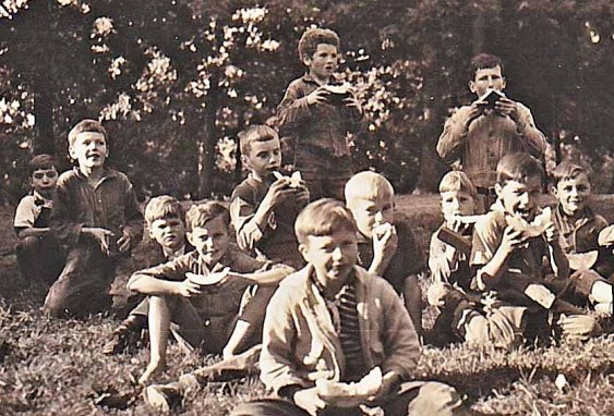 Curly (standing in the back) enjoying a watermelon break with his orphanage brothers