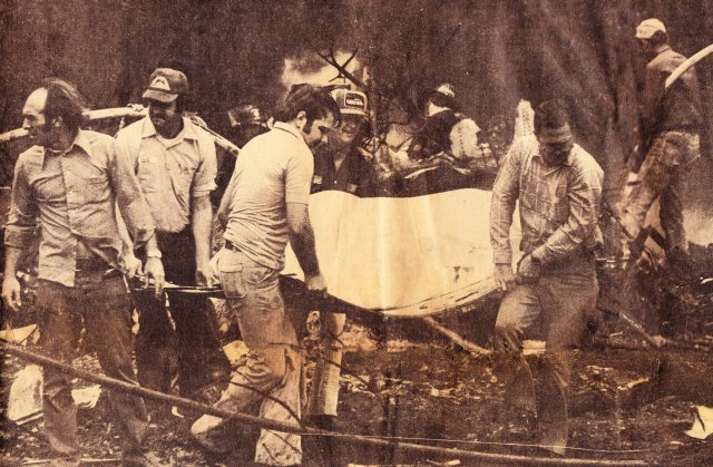 First responders removing a victim from the crash site