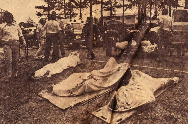 Bodies of the crash victims lined up in front of John Clayton's house on April 4, 1977
