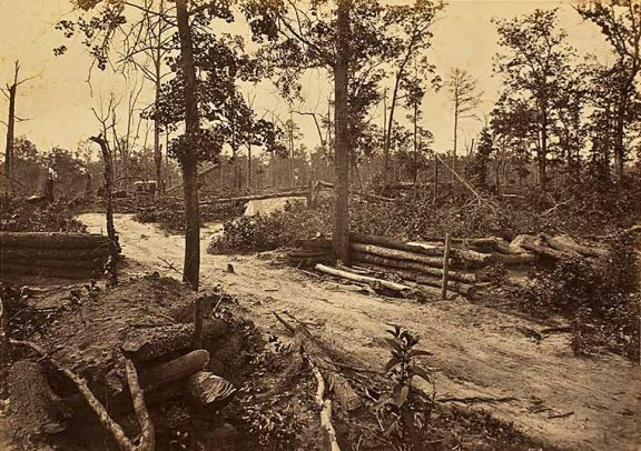 Defensive works after the battle of New Hope Church, New Hope, GA. Note the sightseers in the horse driven carriage in the back.