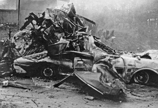 The remains of a Dodge Dart and Toyota in front of Newman's Store. There were seven people from one family that were killed as they sat in the Toyota: Edna Gamel, 23, her 5-year-old son John and 11-month-old daughter Courtney; Kathy Carter, 18, and her 5-month-old son Jeffrey; and Faye Griffin, 22, and her 6-month-old son Larry Jr.