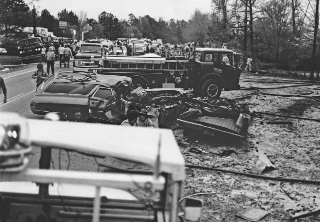 View of car wreckage in front of Newmans Store