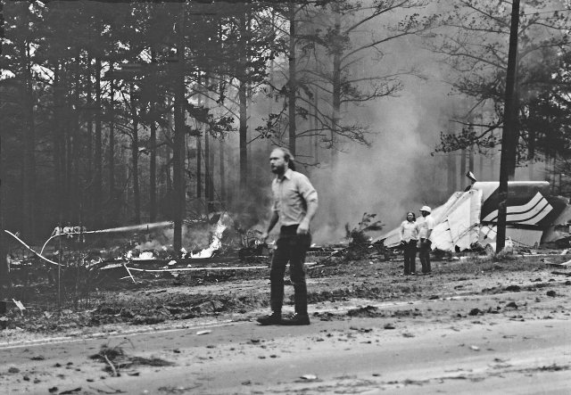 First responder walking away in shock from what he has just seen at the crash site