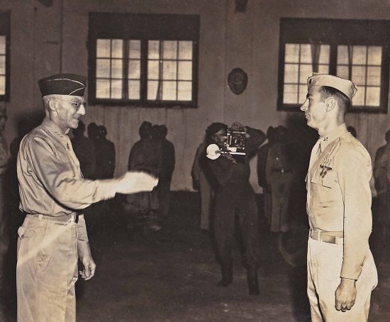 Capt. C. James Crysler receiving the Distinguished Flying Cross from Gen. Joseph Stilwell