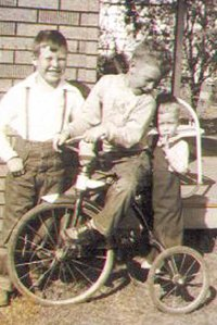 Jimmy (on the bike) keeping a close eye on his brother Earl