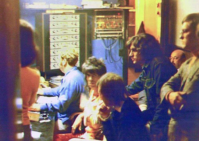 (L-R) Bill Wyman, Jimmy Johnson, Keith Richards, Charlie Watts, unknown crew member, Ahmet Ertegun (president of Atlantic Records), and Terry Woodford at the Muscle Shoals Sound Studio in Sheffield, Alabama. The Rolling Stones recorded Brown Sugar, Wild Horses, and You Gotta Move at MSSS from December 2-4, 1969.