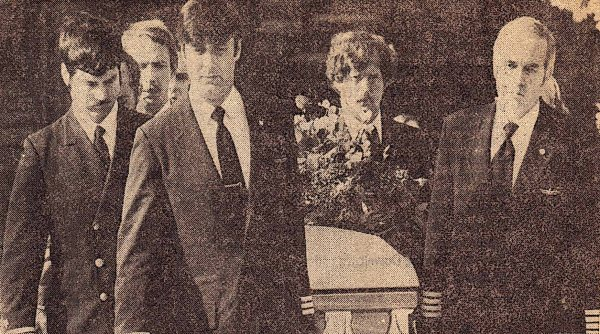 Ron Crysler (far left) acts as one of the pallbearers at Lyman W. Keele's funeral